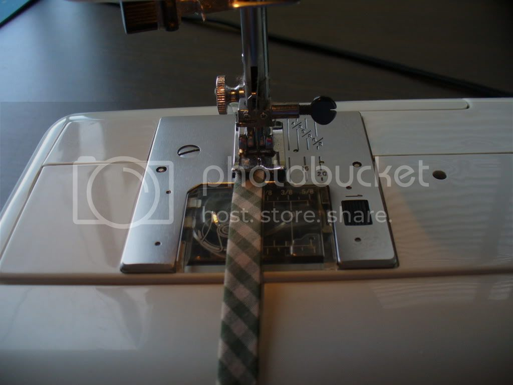 sew down close to the edge of both sides of the tape for the hand towel and the pot holder posts